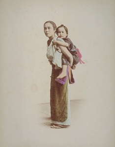 A woman carrying a child on her back_RStillfried