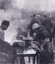 Eating simple food at a black market
